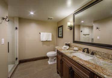 Bathroom with single vanity, toilet, and walk-in shower in a Two-Bedroom Signature Collection villa at Scottsdale Resort in Arizona
