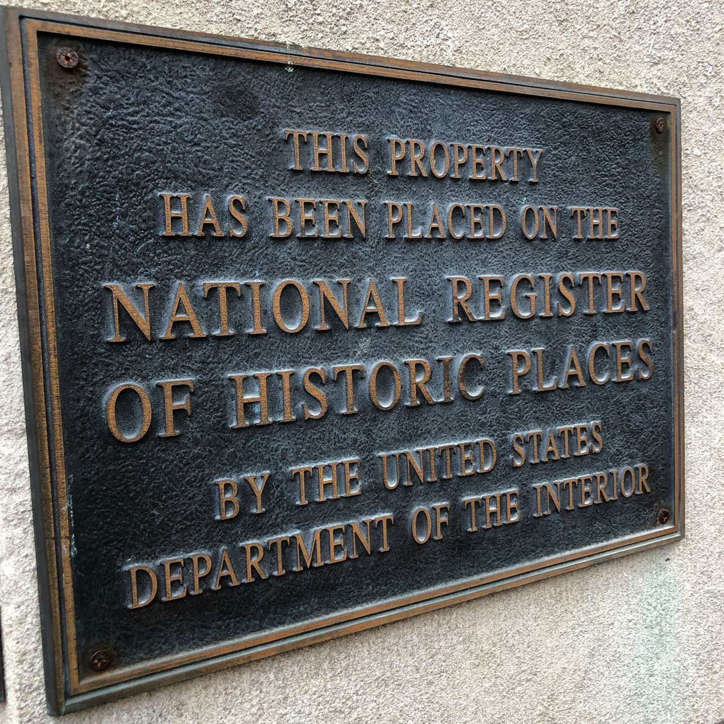 A plaque on the exterior of our New Orleans Resort in Louisiana. It read, 'This property has been placed on the National Register of Historic Places by the United States Department of the Interior.'