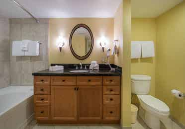 Bathroom with shower/tub combination and sink with mirror in a one bedroom villa in West Village at Orange Lake Resort near Orlando, FL