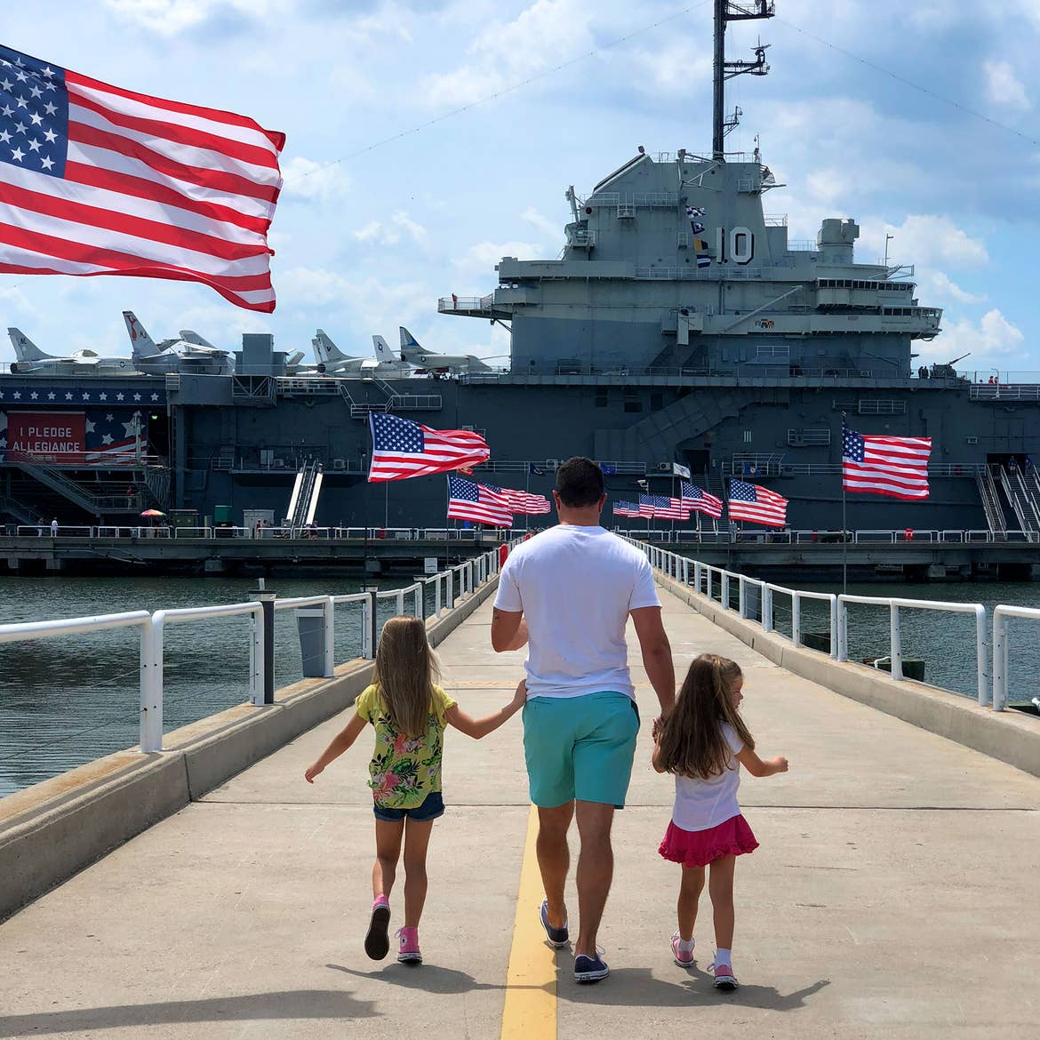 Author, Chris Johnstons' husband, Josh (middle), walks towards the USS Yorktown CV-10 Museum in Charleston with their daughters Kyndall (left) and Kyler (right).