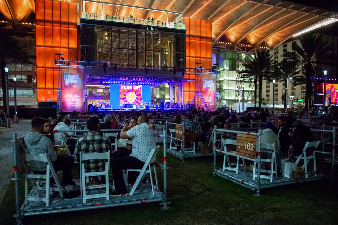 Exterior of the Dr. Phillips center with socially distant boxes for up to five people to watch live entertainment while dining.