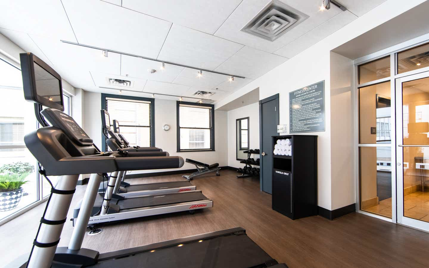 Fitness center with treadmills and free weights at New Orleans Resort in Louisiana.