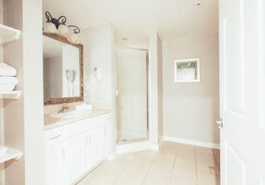 Full bathroom with walk-in shower in a villa in River Island at Orange Lake Resort near Orlando, Florida