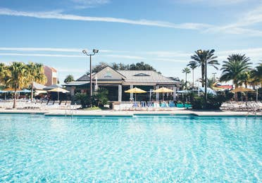 Outdoor pool and view of Breezes Restaurant & Bar in West Village at Orange Lake Resort near Orlando, Florida