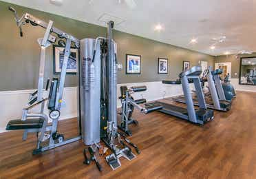 Fitness center with weights and treadmills at Orlando Breeze Resort near Orlando, Florida.