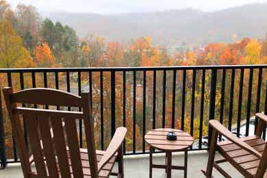 The two rocking chairs on the balcony of our two-bedroom villa at Smoky Mountain Resort overlooking the fall foliage.