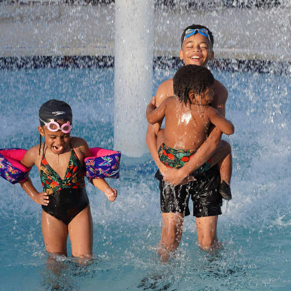 Featured Contributor, Tina Meeks' children stand in the splash pool of our Orange Lake resort in Orlando, Florida.