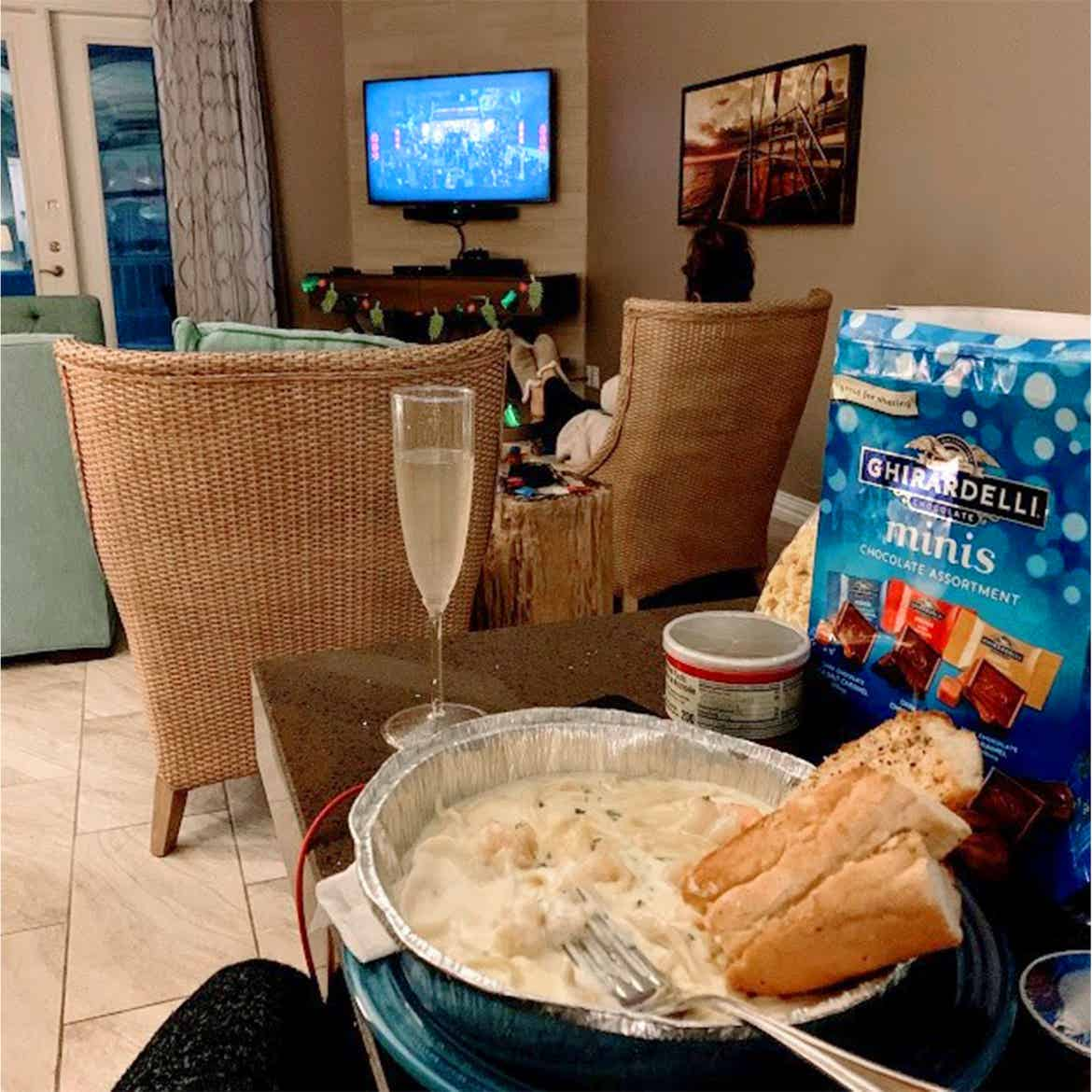 Champagne, chocolates and pasta placed on a table inside the villa of our Galveston Beach Resort in Galveston, Tx.