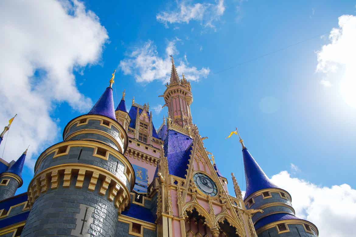 Cinderella Castle under a blue and cloudy sky at the Magic Kingdom Park only at Walt Disney World® Resort.