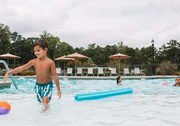 Toddler walking out of a pool at Williamsburg Resort