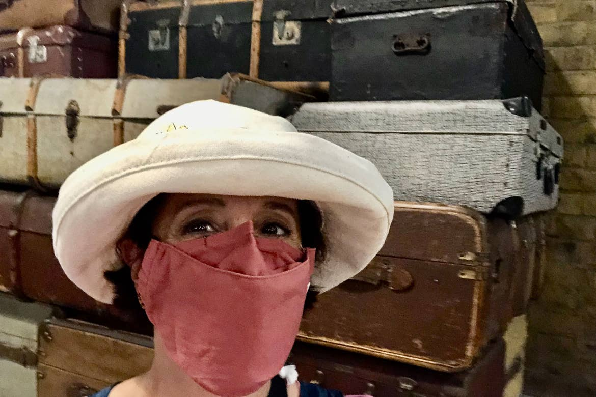 Author, Rona, stands in front of suitcases that are ready to be loaded onto the Hogwarts Express.