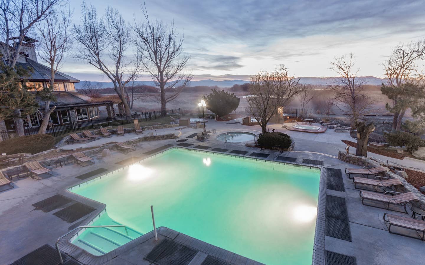Outdoor pool with view of Sierra Nevada Mountains at David Walley's Resort in Genoa, Nevada.