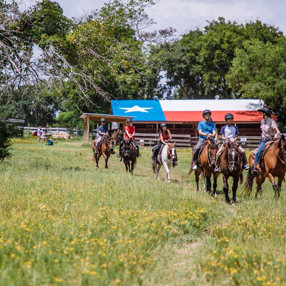Guests riding horses at Villages Resort in Flint, Texas.