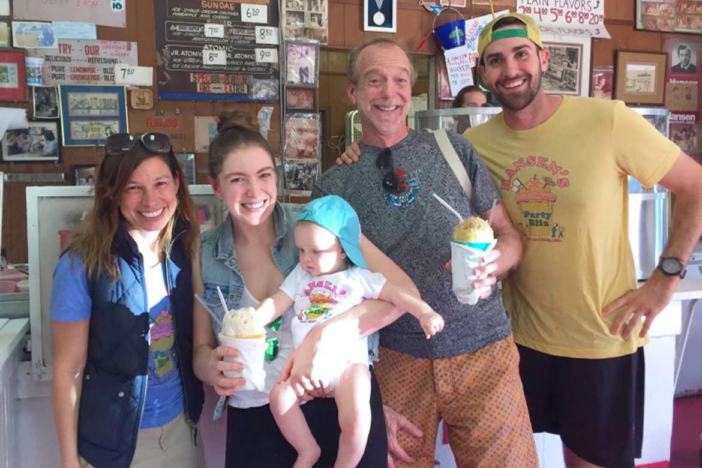 A family enjoys some Sno-balls indoors at Hansen's Sno-Bliz.