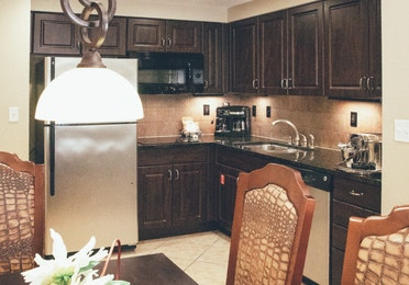 Full kitchen with stainless steel appliances in a Signature villa in River Island at Orange Lake Resort near Orlando, Florida