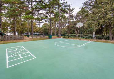 Outdoor basketball court and games at Lake O' the Wood Resort in Flint Texas.