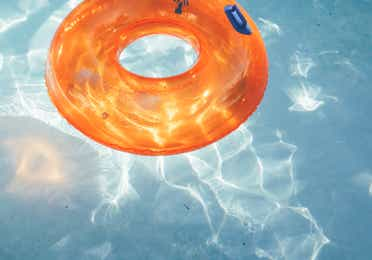 Inter-tube floating in pool in River Island at Orange Lake Resort near Orlando, Florida
