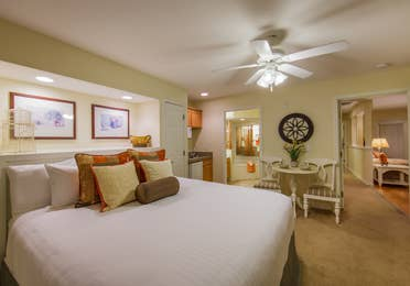 Bedroom with table and chairs in a two-bedroom presidential villa at the Holiday Hills Resort in Branson Missouri.
