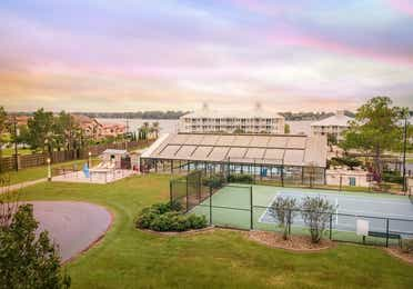 Aerial view of Piney Shores Resort in Conroe, Texas with pool, basketball court, and hot tub
