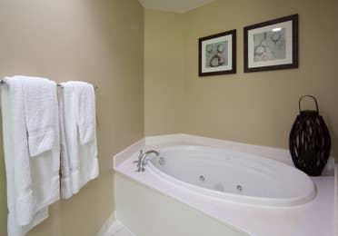 Bathroom with spa tub in a two-bedroom villa at Galveston Beach Resort