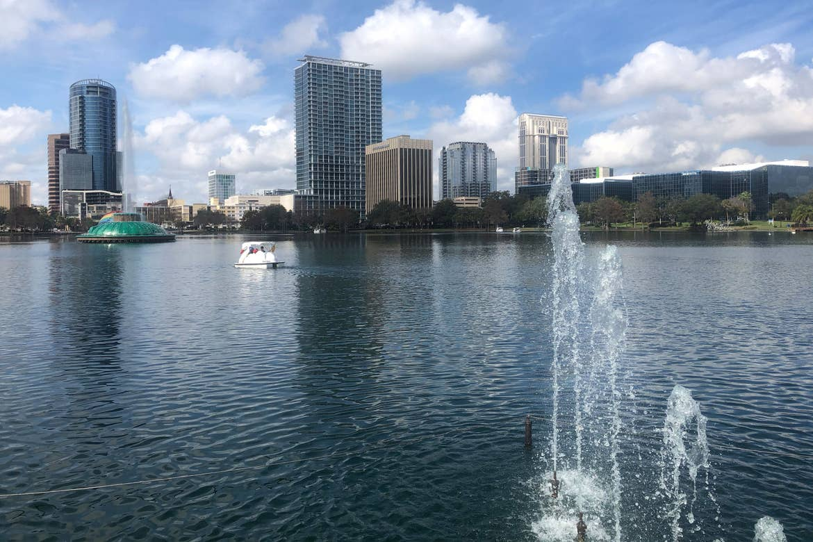 Lake Eola skyline with Swan boat and water feature.