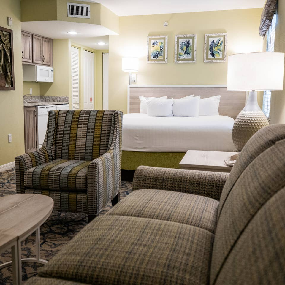 Couch, kitchenette and bed in a studio villa at Cape Canaveral Resort.