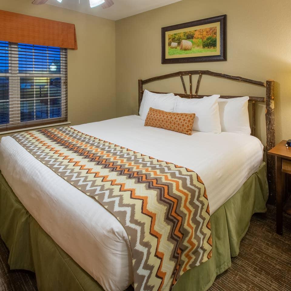 Bedroom in a two-bedroom villa at Timber Creek Resort