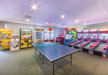 Game room at Oak n' Spruce Resort in South Lee, Massachusetts with table tennis, ski ball, and various other game machines