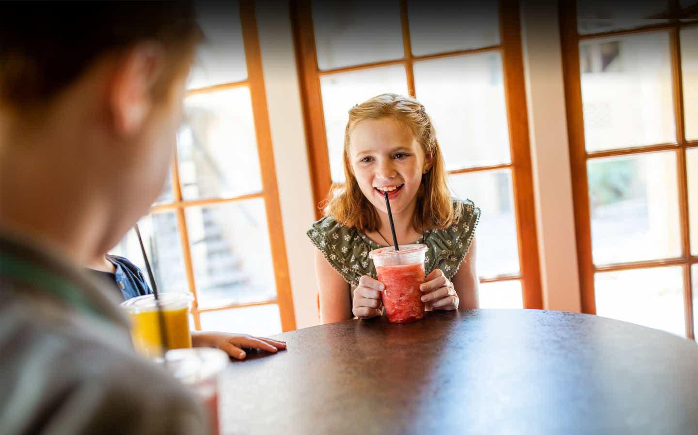 Child enjoying an icee beverage at Galveston Seaside Resort.