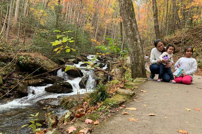 Featured author, Andrea Beltran, sister (left) poses with her two nieces (middle and right) near Anna Ruby Falls waterfall.