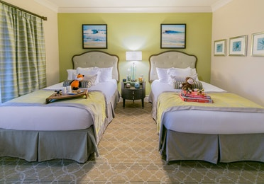 Guest bedroom with two beds in a four-bedroom Signature Collection villa at South Beach Resort
