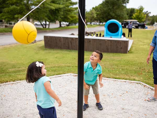 Two children playing tetherball at Holiday Hills Resort in Branson, Missouri.