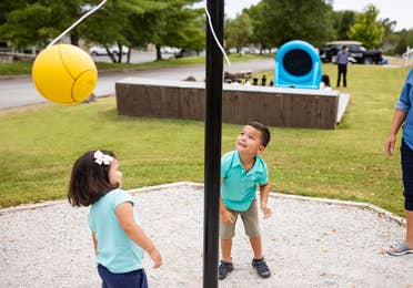 Two children playing tetherball at Holiday Hills Resort in Branson, Missouri