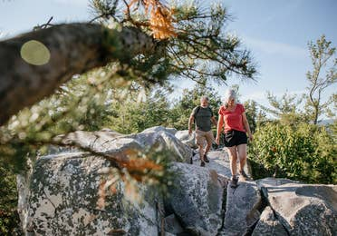 Couple hiking at Monument Mountain near Oak n' Spruce Resort in South Lee, Massachusetts.
