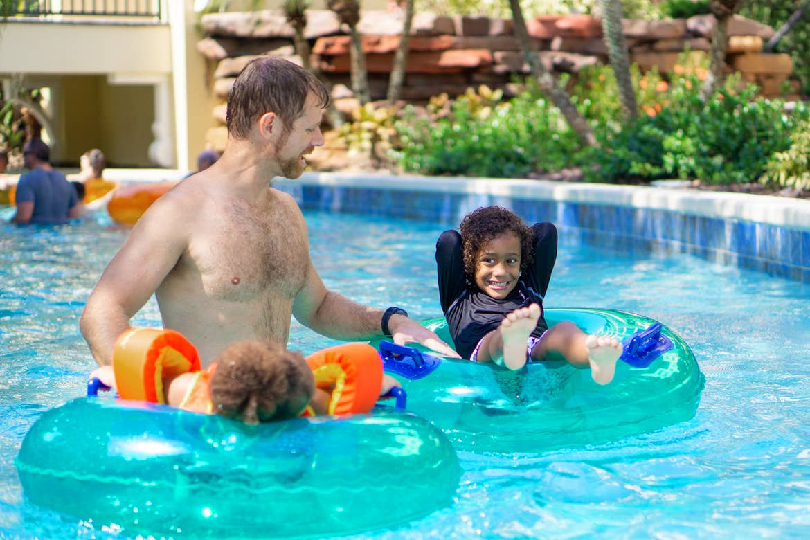 Sally Butan's husband and two children float along the lazy river at our Orange Lake resort.
