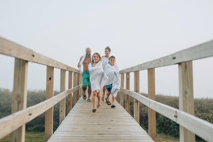 Family walking down a pier