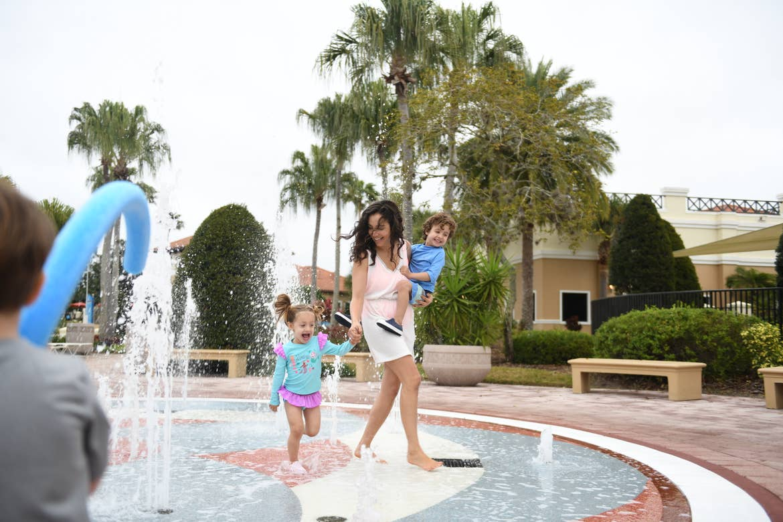 Raff's family enjoying a splash pad in North Village