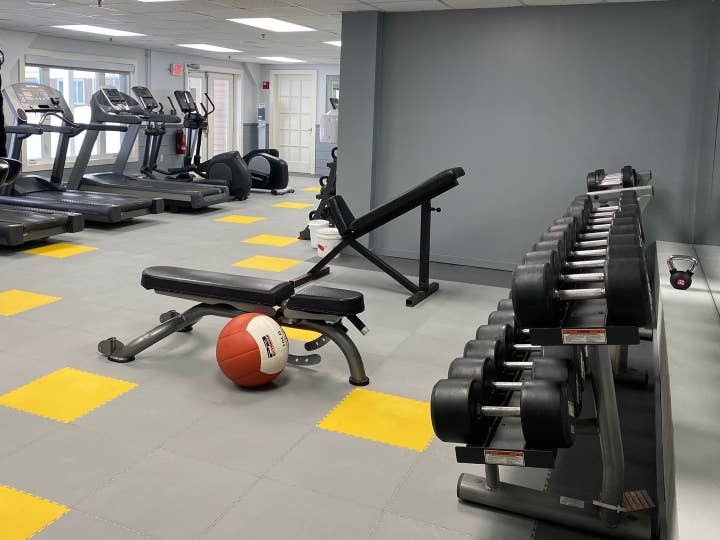 Fitness center with dumbbells, weight benches and treadmills at Mount Ascutney Resort in Brownsville, Vermont.