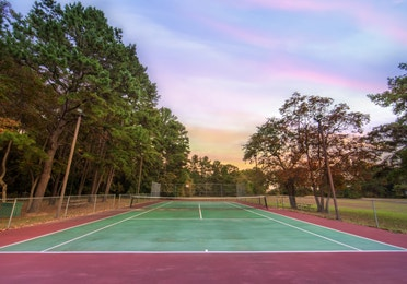 Outdoor tennis court at Lake O' the Wood Resort in Flint Texas.