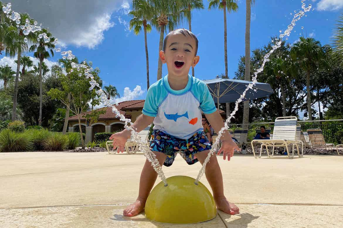 Author, Danny Pitaluga's son, Joey, wears his swimsuit near a fountain park area at our Orange Lake Resort located in Orlando, Florida.