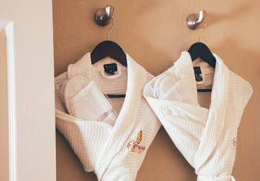Closeup of white complimentary robes in a Signature villa in River Island at Orange Lake Resort near Orlando, Florida