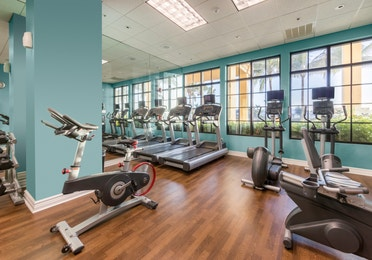 Fitness center with treadmills and elliptical machines at Sunset Cove Resort