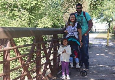 Featured Contributor, Karishma Kittur (top-left), her husband, Rohan (top-right) and two daughters, Myrra (front-left) and Amarra (front-right).