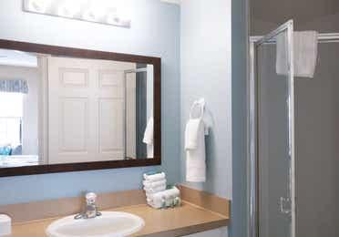 Bathroom with walk-in shower in a villa in East Village at Orange Lake Resort near Orlando, Florida