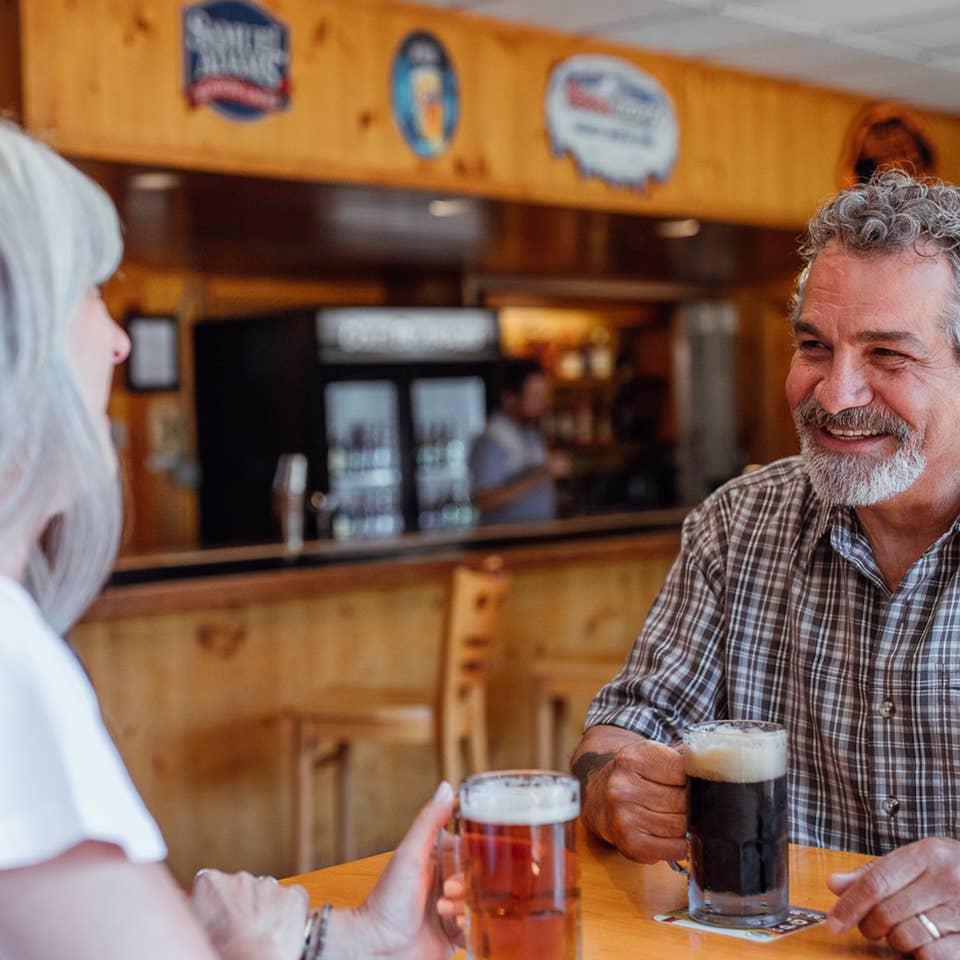 Couple having drinks at Beartree Bar at Oak n' Spruce Resort in South Lee, Massachusetts.