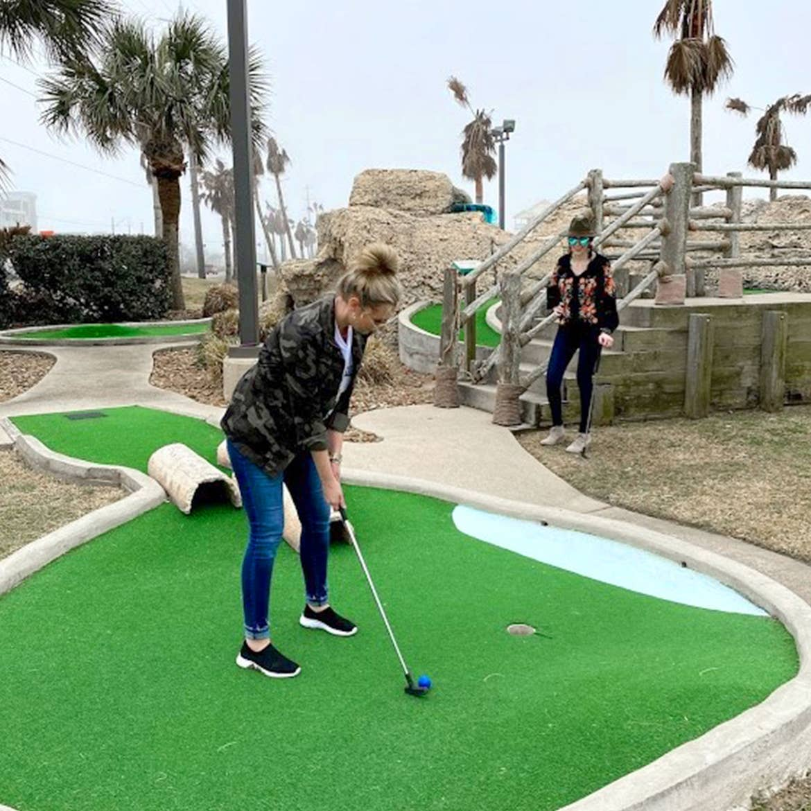 Featured Contributor, Amanda Nall (left) plays mini-golf with her friend at our Galveston Beach Resort in Galveston, Tx.