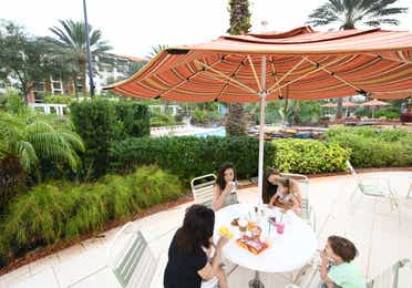 Outdoor dining tables under umbrellas at Orange Lake Resort near Orlando, Florida