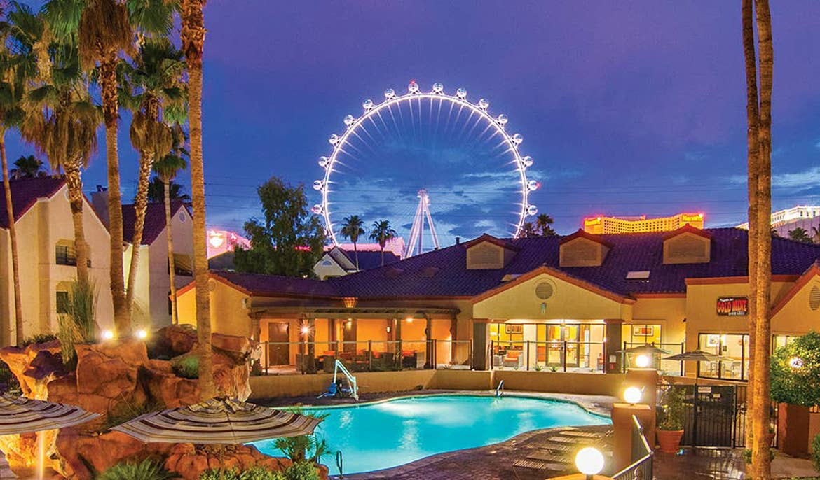 Pool at Desert Club Resort in Las Vegas with the 'High Roller' ferris wheel in the background.