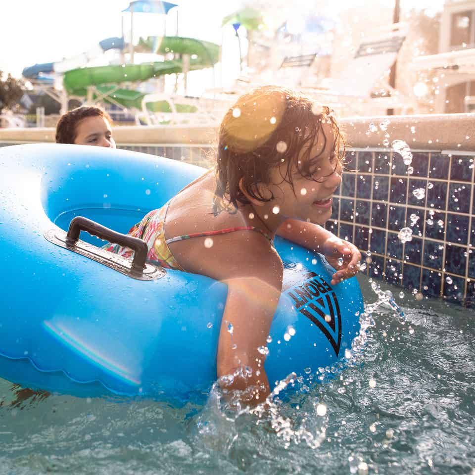 Child in inner-tube floating down lazy river at South Beach Resort in Myrtle Beach, South Carolina.
