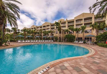 Outdoor pool surrounded by palm trees at Cape Canaveral Beach Resort.